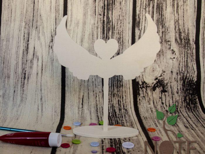 suport din lemn cu aripi